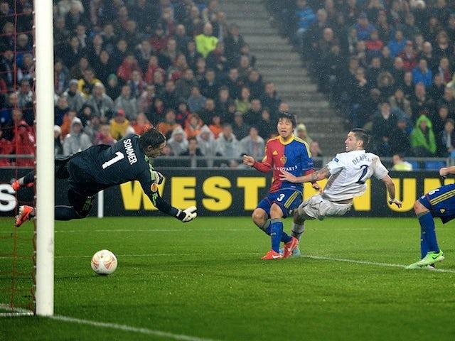Spurs' Clint Dempsey scores his second goal against Basel on April 11, 2013
