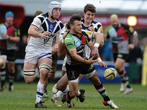 Harlequins' Danny Care is tackled by Bath's Stephen Donald on April 13, 2013