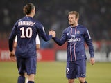 David Beckham and Zlatan Ibrahimovic shake hands after a goal against Montpellier on March 29, 2013