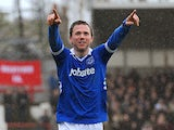 Portsmouth's David Connolly celebrates after scoring the equaliser against Brentford on April 13, 2013