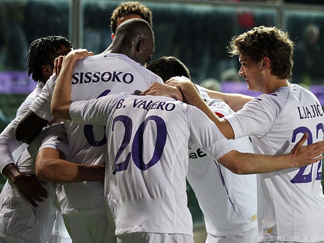Fiorentina's David Pizarro is mobbed by teammates after scoring the opening goal against Atalanta on April 13, 2013