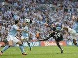 Chelsea striker Demba Ba scores against Man City on April 14, 2013