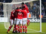 Benfica's Eduardo Salvio is mobbed by teammates after his equaliser against Newcastle on April 11, 2013