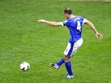 Everton's Darron Gibson scores against QPR in the Premier League clash on April 13, 2013