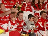 Ferrari driver Fernando Alonso celebrates with teammates after winning the Chinese GP on April 14, 2013