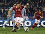 Roma captain Francesco Totti scores a penalty against Lazio on April 8, 2013
