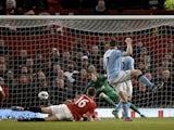 James Milner opens the scoring for City against United on April 8, 2013