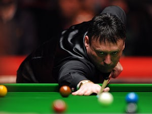 Jimmy White secures spot in round two of UK Championship