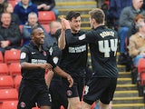 Charton's Johnnie Jackson is congratulated by teammates after scoring his team's second against Barnsley on April 14, 2013