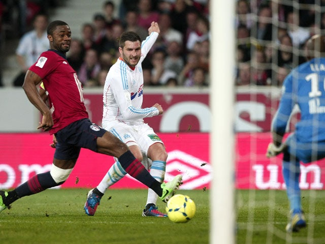 Marseille's forward Andre-Pierre Gignac has a shot on goal during the Ligue 1 clash with Lille on April 14, 2013