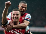 Lukas Podolski is congratulated by Kieran Gibbs after scoring his team's second goal against Norwich on April 13, 2013