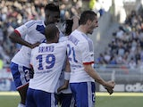 Lyon players celebrate following a goal in their match against Toulouse on April 14, 2013