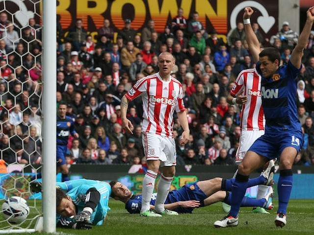 United's Michael Carrick lays on the ground to watch his shot go in against Stoke on April 14, 2013