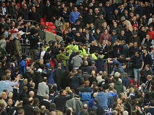 Millwall vow to ban violent fans