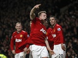 United defender Phil Jones celebrates an own goal by Vincent Kompany during the Manchester Derby on April 8, 2013