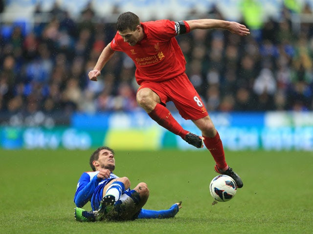 Liverpool's Steven Gerrard is tackled by Reading's Daniel Carrico during the goalless draw on April 13, 2013