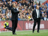 Opposing bosses Roberto Mancini and Rafa Benitez stand on the touchline during the FA Cup semi-final on April 14, 2013