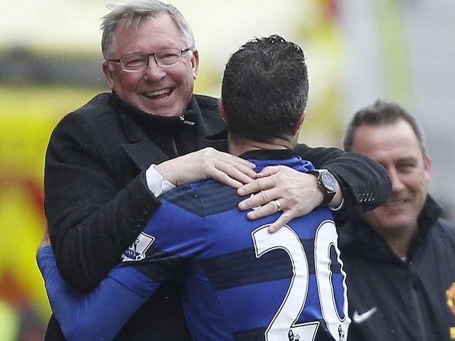 United striker Robin Van Persie celebrates with Sir Alex Ferguson after scoring a penalty against Stoke on April 14, 2013