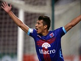 Tigre's Ruben Botta celebrates after scoring in the match against Deportivo Anzoategui on January 29, 2013