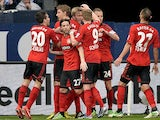 Leverkusen's Simon Rolfes is congratulated by teammates after scoring the opener against Schalke on April 13, 2013