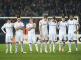 Spurs players stand dejected after losing on penalties to Basel on April 11, 2013