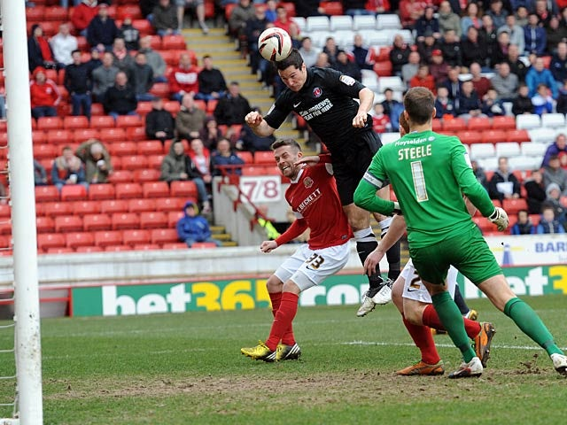 Charlton's Yann Kermorgant heads in his team's third goal in the match against Barnsley on April 13, 2013