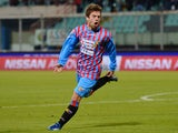 Catania forward Alejandro Gomez celebrates after scoring against Udinese on March 16, 2013