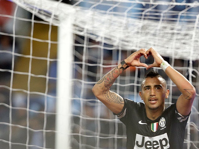 Juventus' Arturo Vidal celebrates after scoring the opening goal in the match against Lazio on April 15, 2013
