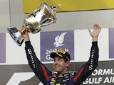 Red Bull driver Sebastian Vettel celebrates with the trophy after winning the Bahrain Grand Prix Sunday on April 21, 2013