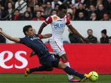 Nancy's forward Benjamin Moukandjo is tackled by PSG's Thiago Silva during the Ligue 1 clash on March 9, 2013