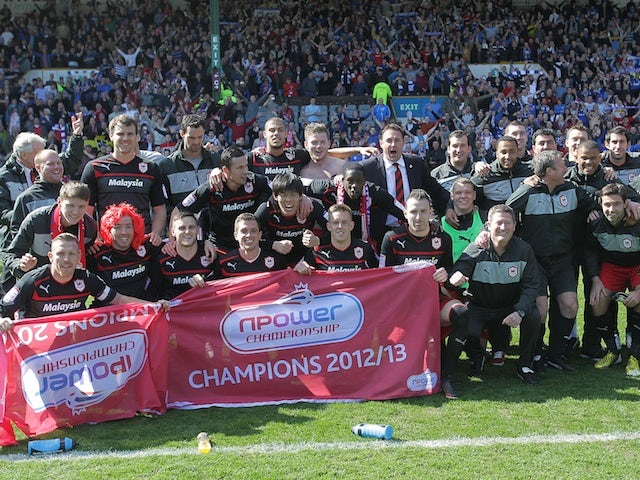 Cardiff celebrate being promoted as champions of the Npower Championship on April 20, 2013