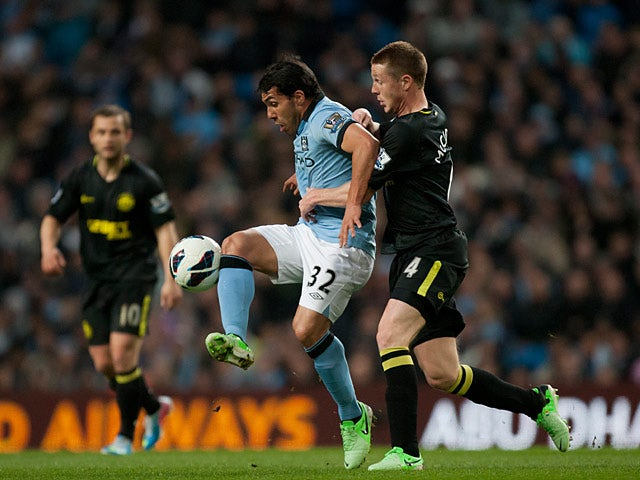Carlos Tevez and James McCarthy battle for the ball on April 17, 2013