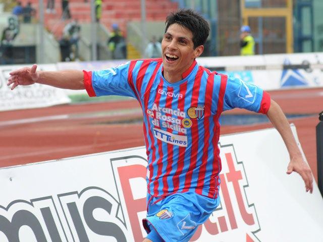 Catania midfielder Pablo Barientos celebrates after scoring against Palermo on April 21, 2013