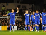 David Luiz celebrates with teammates after scoring the opening goal against Fulham on April 17, 2013