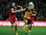 Hull City's Matty Fryatt and Bristol City's Brendan Moloney battle for the ball during the Championship match on April 19, 2013