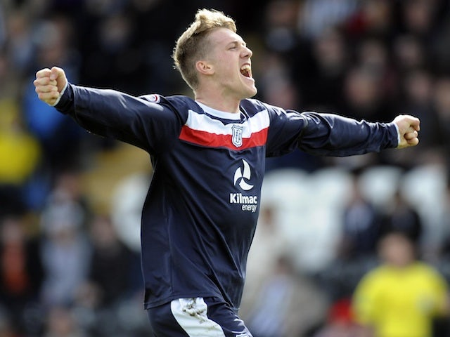 Dundee's James McAlister celebrates his goal against St Mirren on April 20, 2013