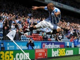 Huddersfield forward James Vaughan celebrates a goal against Millwall on April 20, 2013