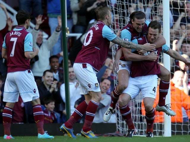 West Ham's Kevin Nolan is congratulated after a goal against Wigan on April 20, 2013