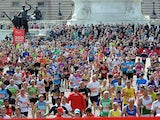 Runners approach the finish line during the London Marathon on April 22, 2012