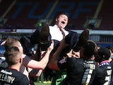 Cardiff manager Malky Mackay is lifted in celebration after his side became champions on April 20, 2013