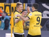 Dortmund striker Marco Reus is congratulated after scoring against Mainz on April 20, 2013