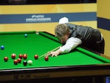 Michael White in action in his match against Mark Williams during the Snooker World Championship on April 21, 2013