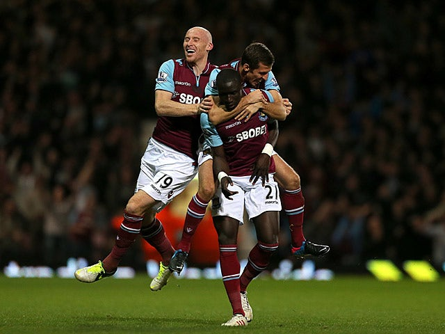 Mohamed Diame is congratulated by teammates Gary O'Neil and James Collins after scoring his team's second against Manchester United on April 17, 2013