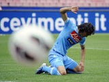 Napoli's Edinson Cavani reacts after missing a scoring chance in the match against Cagliari on April 21, 2013