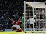Arsenal defender Per Mertesacker opens the scoring against Fulham on April 20, 2013