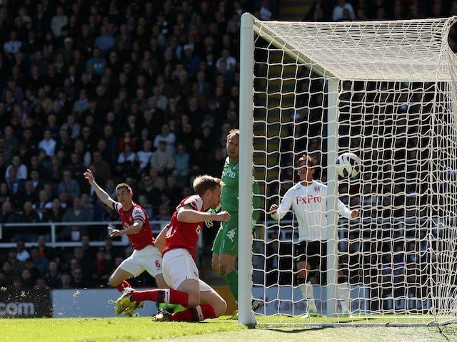Arsenal defender Per Mertesacker opens the scoring against Fulham on April 20, 2013