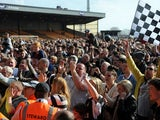 Port Vale fans invade the pitch after the club won promotion to League One on April 20, 2013
