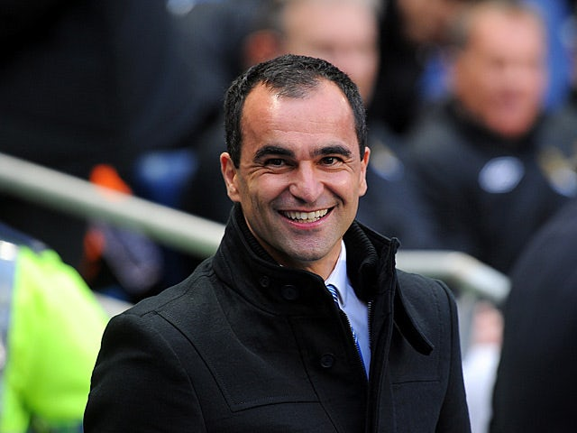 Wigan boss Roberto Martinez smiles prior to kick off in the match against Manchester City on April 17, 2013