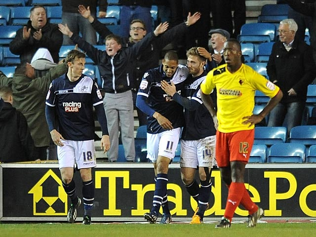 Millwall's Shaun Batt is congratulated by teammates after scoring against Watford on April 16, 2013