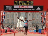 Ethiopia's Tsegaye Kebede crosses the finish line as he wins the Men's Elite race at the Virgin London Marathon on April 21, 2013